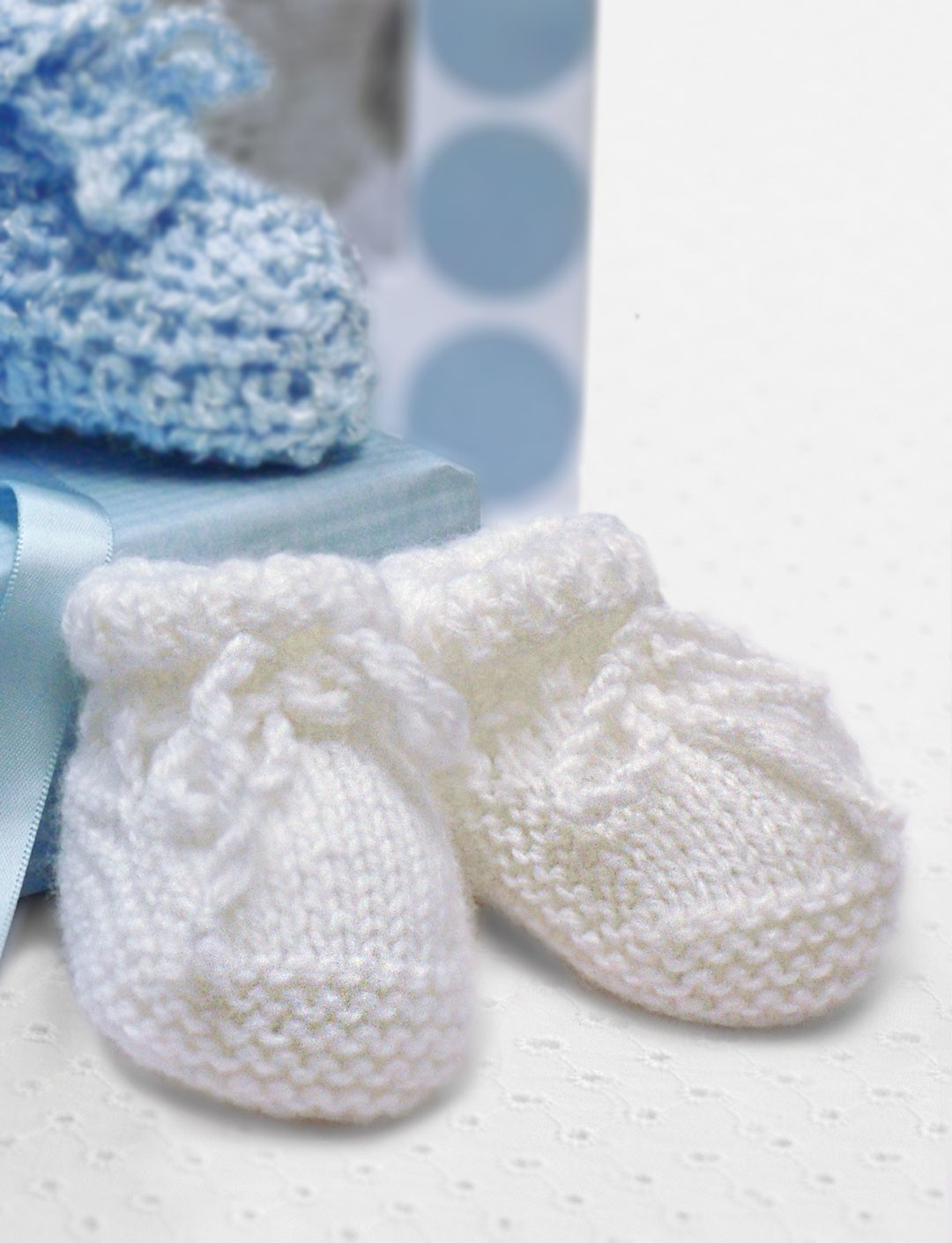 Bernat baby shower booties knit pattern yarnspirations for Baby shower booties template