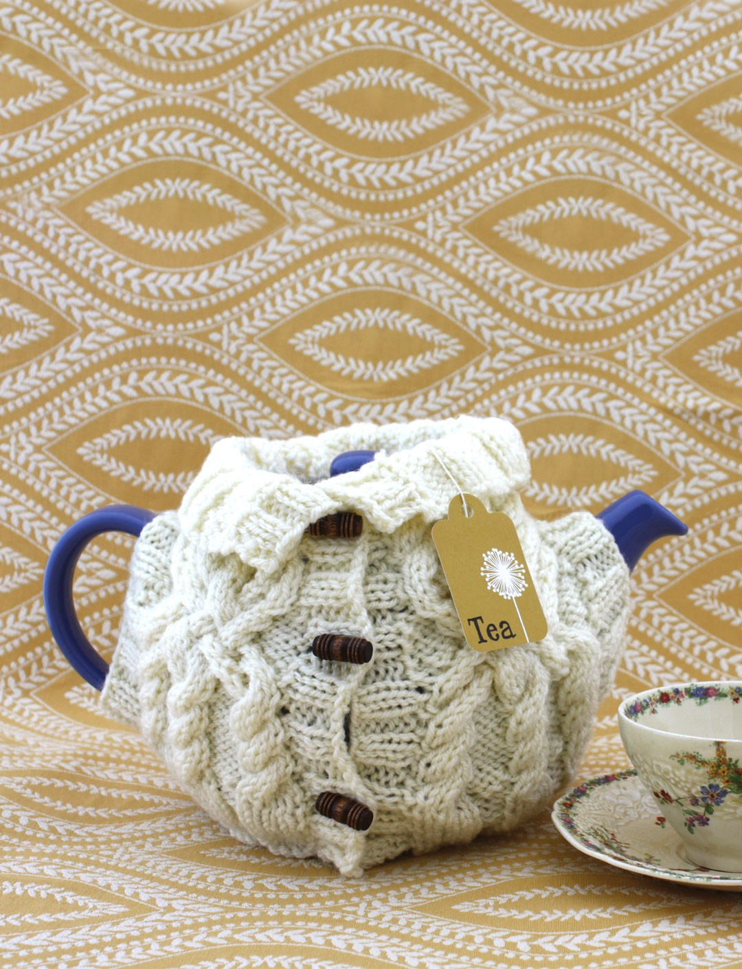 Patons aran sweater tea cozy knit pattern yarnspirations for Tea cosy template