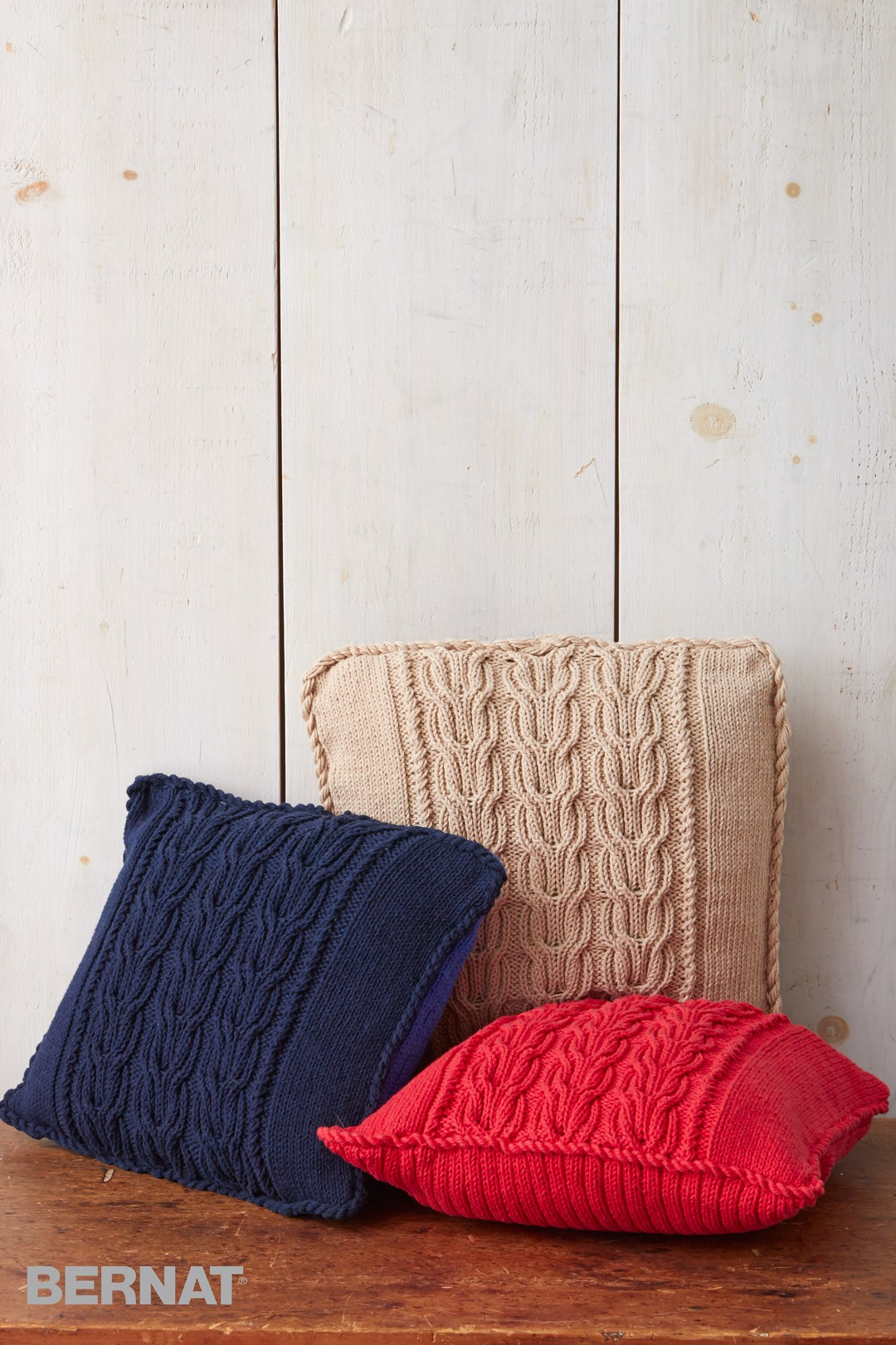 Cable Knit Pillow Pattern : Bernat Cable Knit Trio Pillows, Knit Pattern Yarnspirations