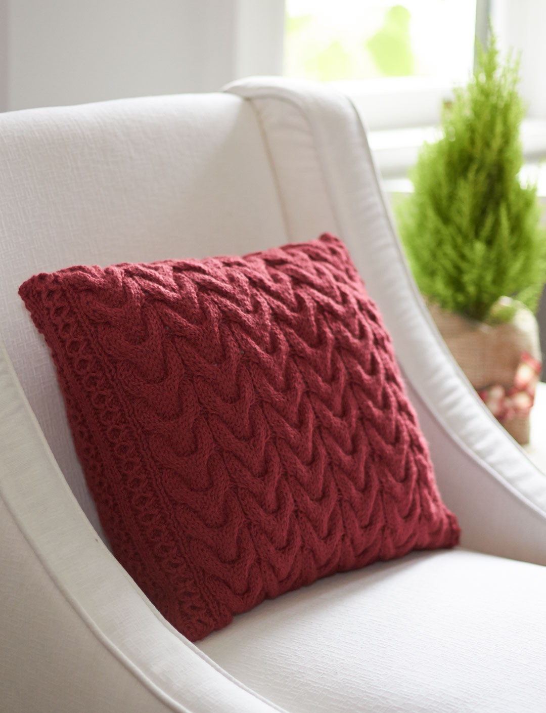 Cable Knit Pillow Pattern Free : Patons Christmas Cables Pillow, Knit Pattern Yarnspirations