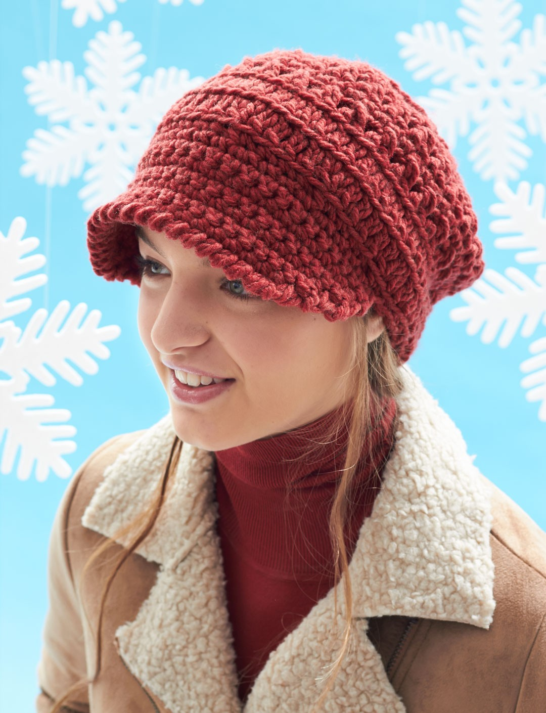 Knitting Pattern For Peaked Beanie : Yarnspirations.com - Bernat Horseshoe Cable Blanket and ...