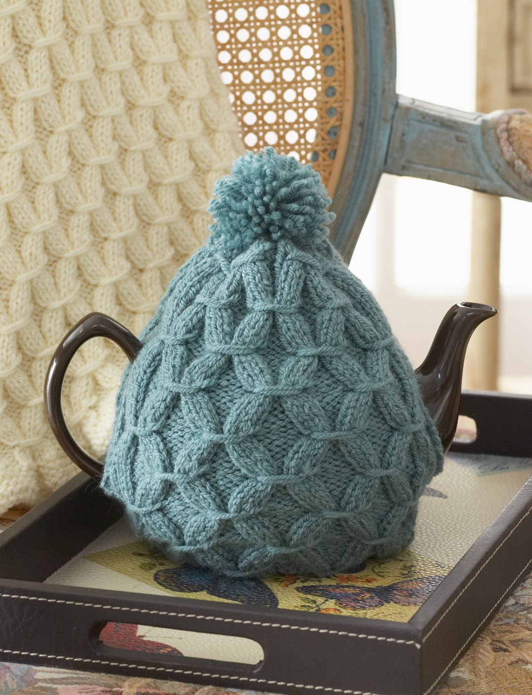 Knitted Teapot Cosy Patterns : Patons Cushy Smocked Throw and Tea Cozy, Knit Pattern Yarnspirations