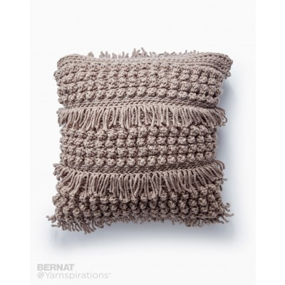 Tassel and Texture Crochet Pillow